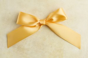 Golden ribbon bow