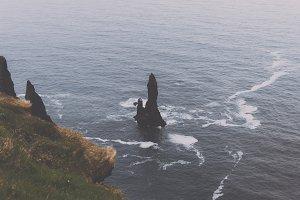 Dark Basalt Rocks in the Ocean