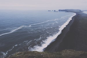 Moody Black Sand Beach and Cliffs