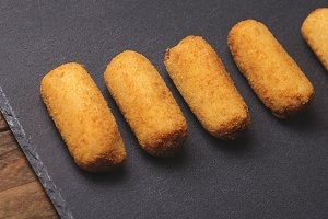 Several croquettes on a slate plate. Horizontal shoot.