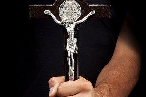 Crucifix in a man's hand