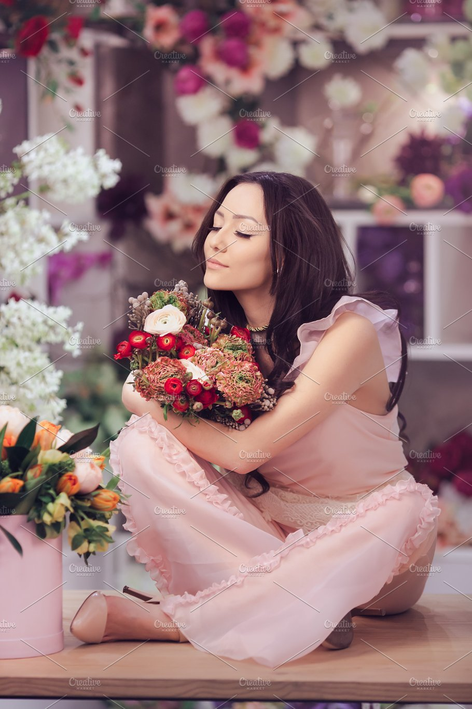 Beautiful asian woman florist in pink dress with bouquet of flowers beautiful asian woman florist in pink dress with bouquet of flowers in hands in flower store people images creative market izmirmasajfo