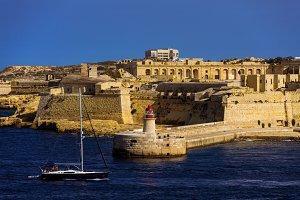 Lighthouse and a Yacht