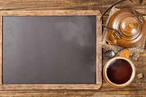 Tea set and chalkboard.
