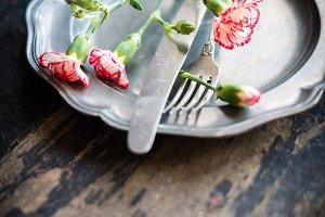 Spring table setting with carnations