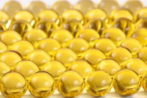 a lot of fish oil capsules as background