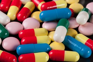 colorful pills on a dark background