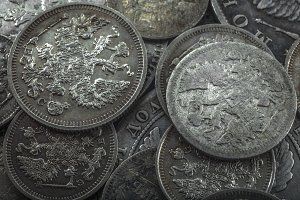 dim gloss of old silver coins