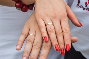 The hands of a newly-married couple after the wedding