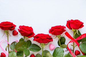red roses and decorative hearts