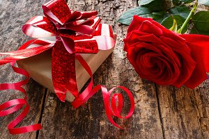 gift and red rose close-up