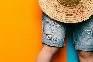 shorts and straw hat. minimal style