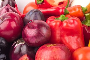 Set of red and purple fresh raw vegetables and fruits