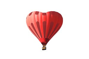 Red air balloon in the shape of a heart isolated on a white background