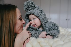 happy mother and her baby girl