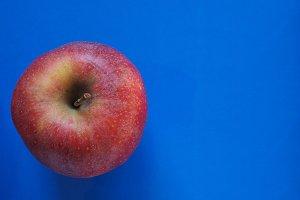red apple fruit food over blue