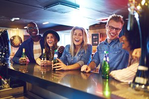 Cheerful party with beer in the bar