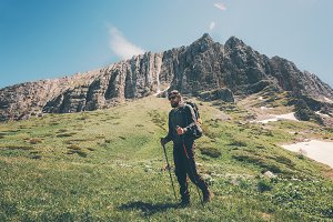 Man traveler hiking in mountains