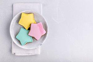 Star cookies on grey plate