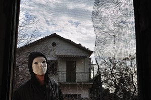 Hooded Figure Old Window