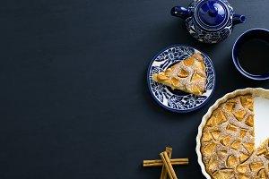 Darkblue tea service with pie