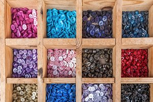 Coloured buttons in wooden box