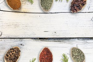 Group of spices on wood background