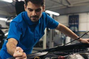 Professional Mechanic Repairing Car