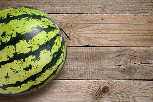 Watermelon on old wooden table