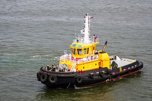 Yellow tug boat on canal