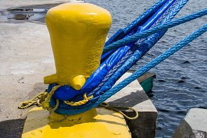 Yellow bollard with blue rope