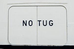 No Tug sign on ship