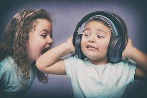 Cheerful kids with headphones