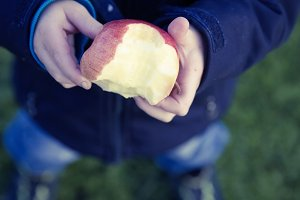 young boy eat apple