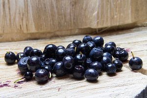 Bilberry. Blueberries wooden background.