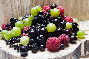 Mixed berries.  and wooden background.