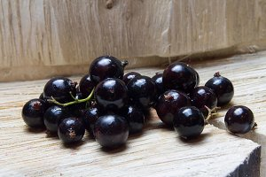 Currant.  wooden background.