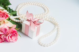 Box with pink ribbon