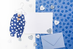 Blank card, envelop and overalls on paper background. Flat lay.