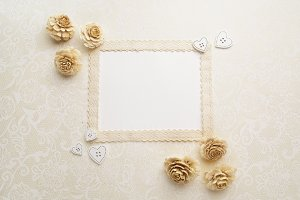 Framework with dry flowers on white background. Flat lay