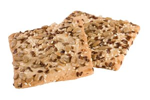 crispy bread with seeds of sunflower, flax and sesame seeds Isolated on white background