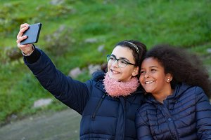 Children taking a photo with mobile