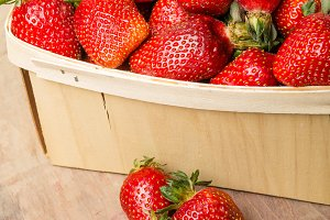 Strawberries and wooden basket