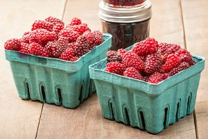 Tayberries and jam with baskets