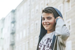 boy listening to music in the city