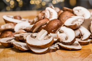 Sliced mushrooms on cutting board