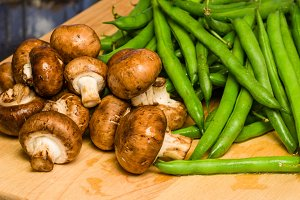 Mushrooms and green beans in kitchen