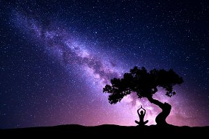 Milky Way. Woman under the tree