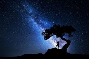 Milky Way. Man under the tree