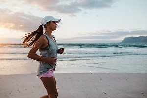 Fit young woman jogging at the beach